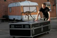 "Esben Horn, founder of 10 tons, is pushing a flight case from ""Rock Fossils on Tour"". Esben is educated graphic designer, set designer and self taught sculptor."